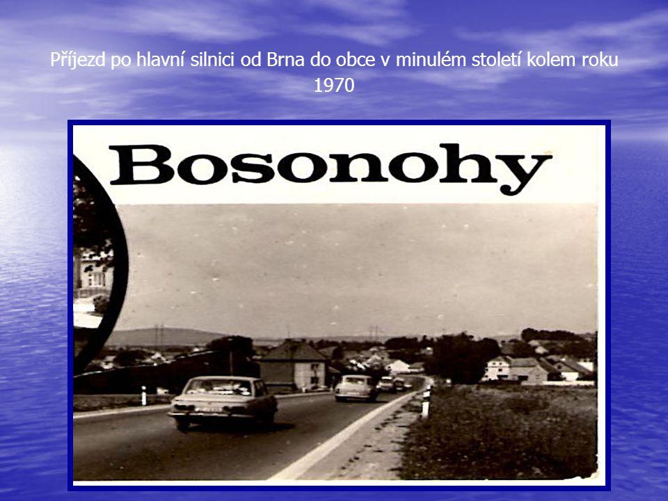 Příjezd po hlavní silnici od Brna do obce v minulém století kolem roku 1970