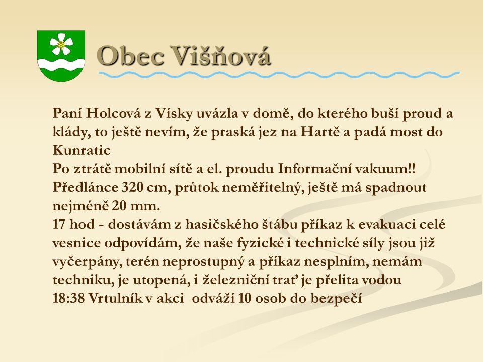 Obec Višňová Paní Holcová z Vísky uvázla v domě, do kterého buší proud a klády, to ještě nevím, že praská jez na Hartě a padá most do Kunratic.