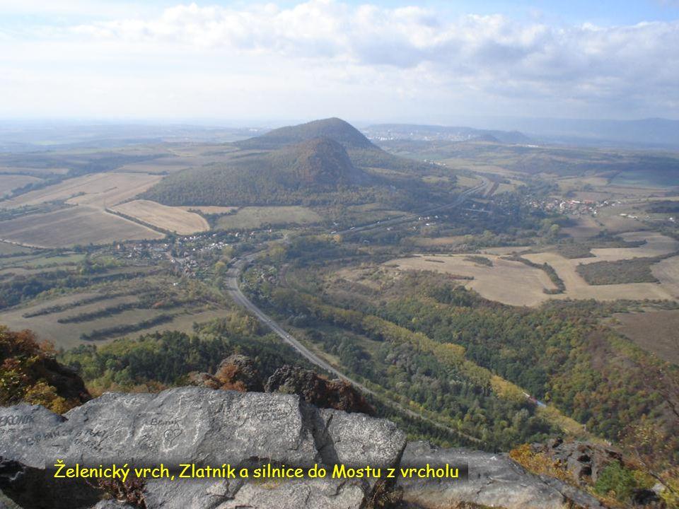 Želenický vrch, Zlatník a silnice do Mostu z vrcholu