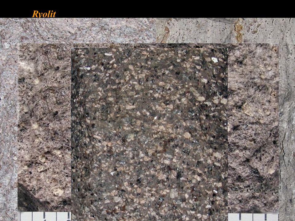Ryolit křemen 20 – 60 % tmavé minerály M = 5 – 15 %, nejčastěji biotit, méně amfiboly a pyroxeny, biotit.