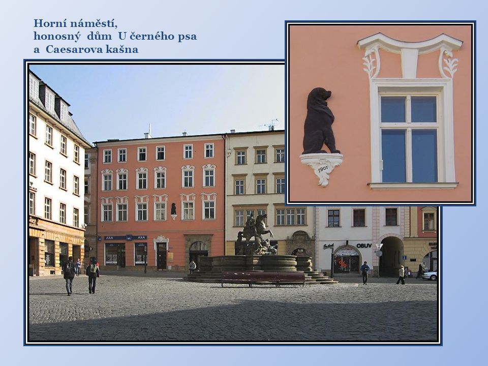 Horní náměstí, honosný dům U černého psa a Caesarova kašna