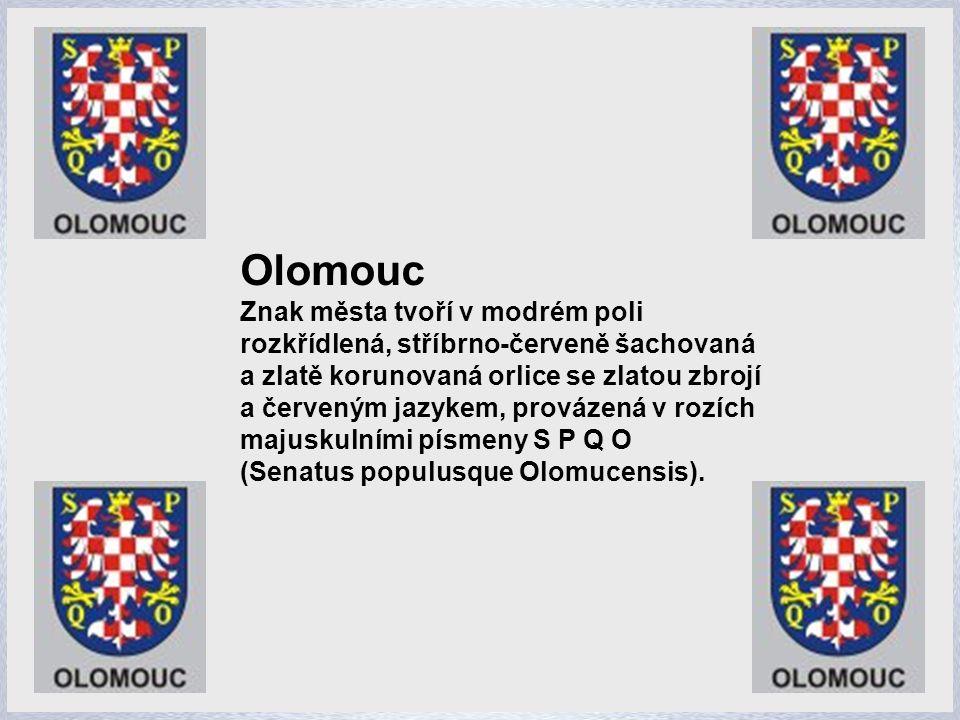 Olomouc Znak města tvoří v modrém poli rozkřídlená, stříbrno-červeně šachovaná
