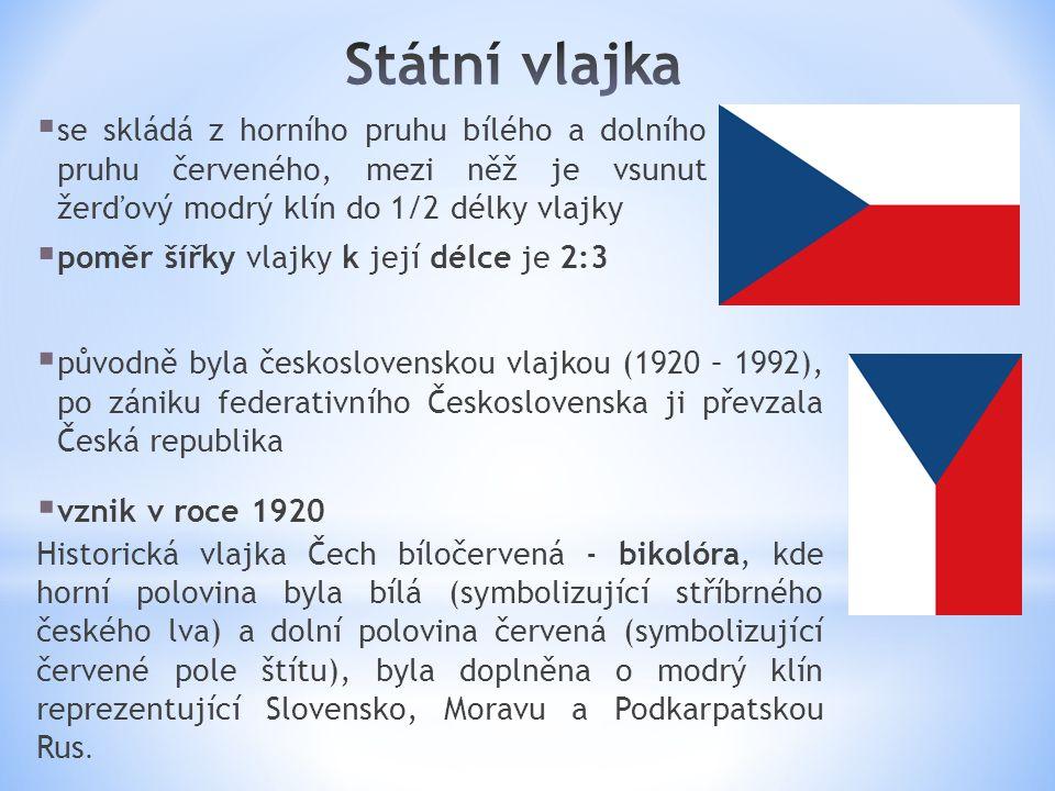 Státní vlajka se skládá z horního pruhu bílého a dolního pruhu červeného, mezi něž je vsunut žerďový modrý klín do 1/2 délky vlajky.