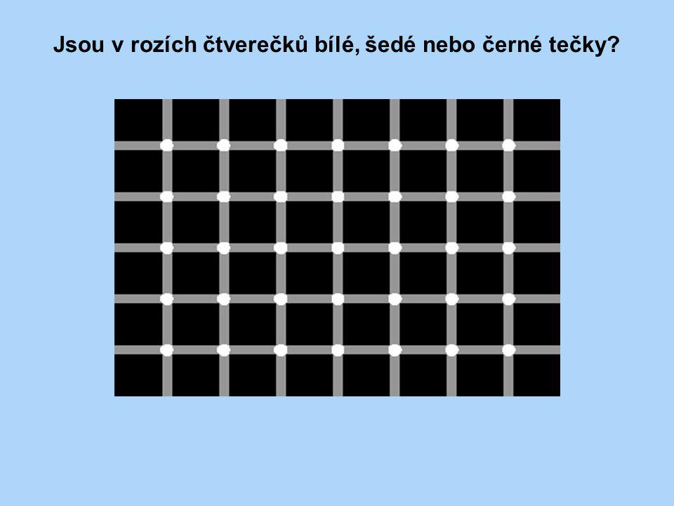Jsou v rozích čtverečků bílé, šedé nebo černé tečky