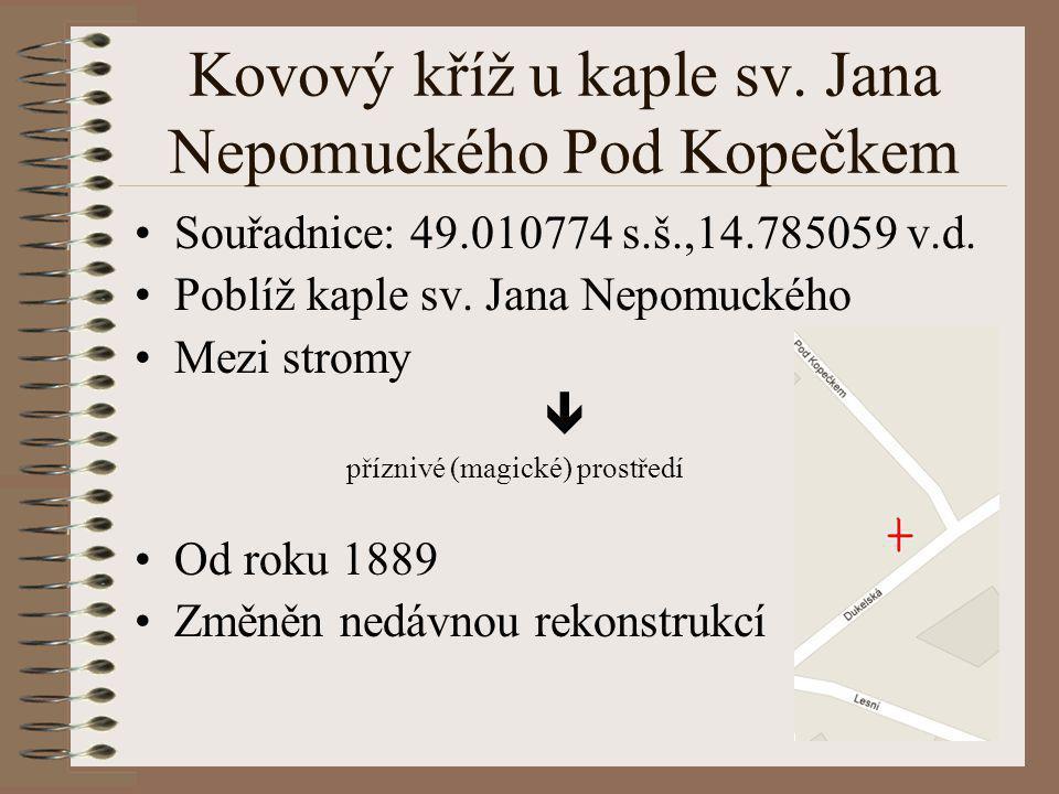 Kovový kříž u kaple sv. Jana Nepomuckého Pod Kopečkem