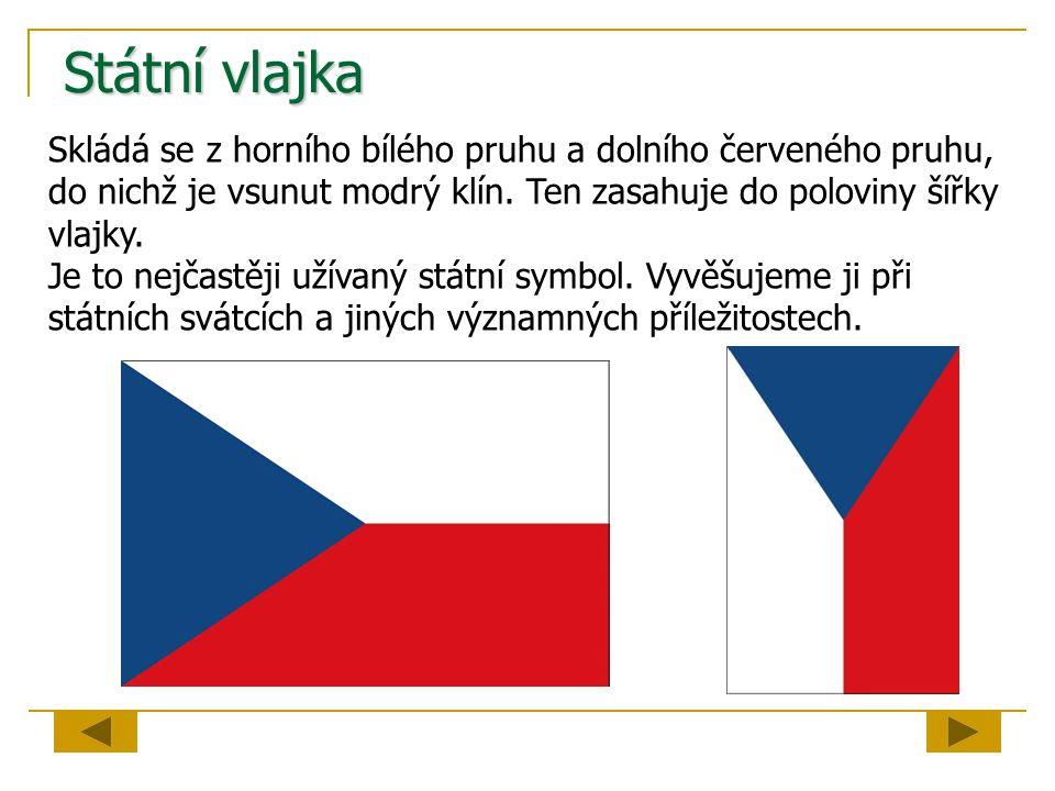 Státní vlajka Skládá se z horního bílého pruhu a dolního červeného pruhu, do nichž je vsunut modrý klín. Ten zasahuje do poloviny šířky vlajky.
