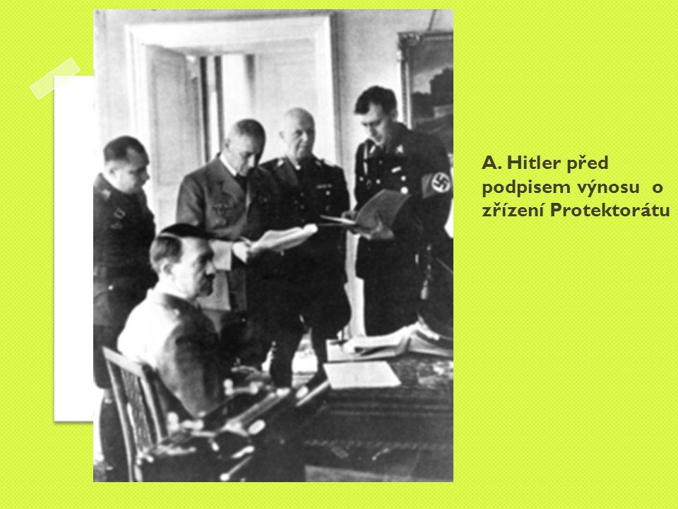 A. Hitler před podpisem výnosu o zřízení Protektorátu