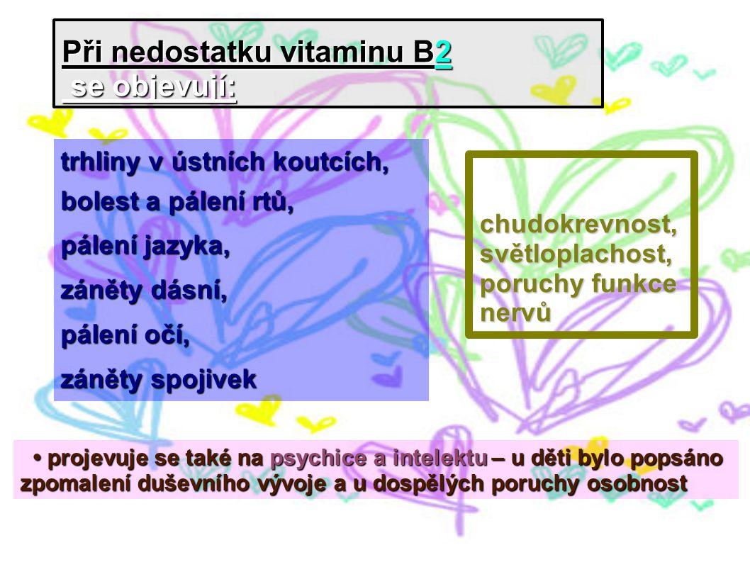 Při nedostatku vitaminu B2 se objevují: