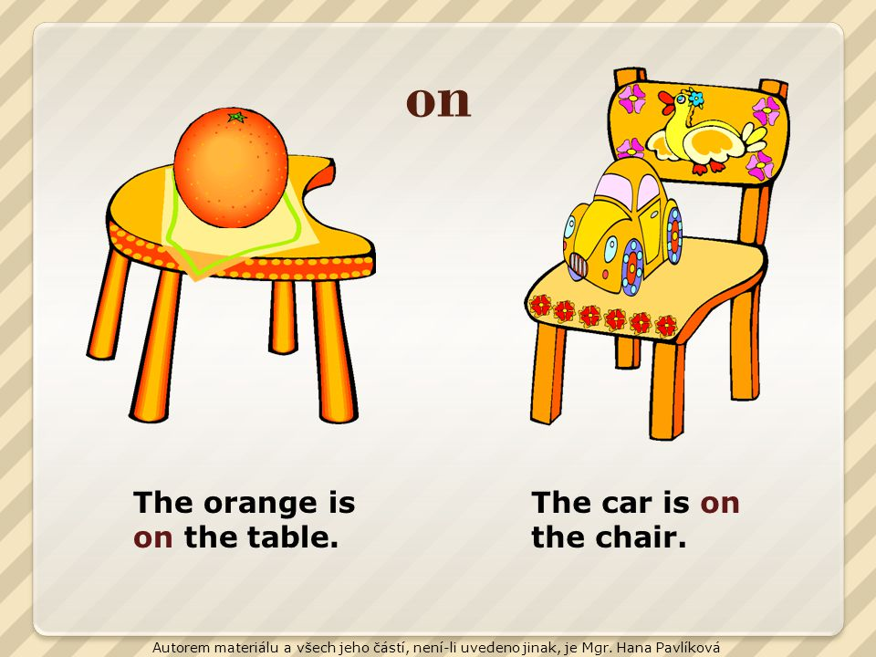 on The orange is on the table. The car is on the chair.