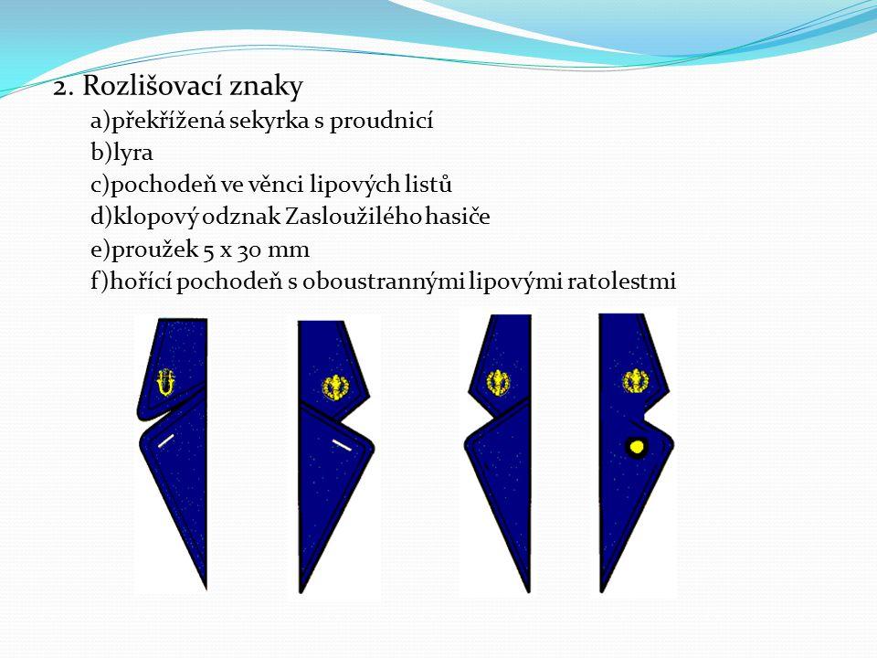 2. Rozlišovací znaky a)překřížená sekyrka s proudnicí b)lyra