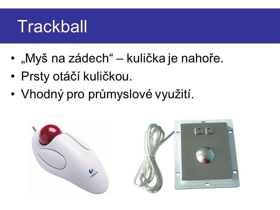 """Trackball """"Myš na zádech – kulička je nahoře. Prsty otáčí kuličkou."""