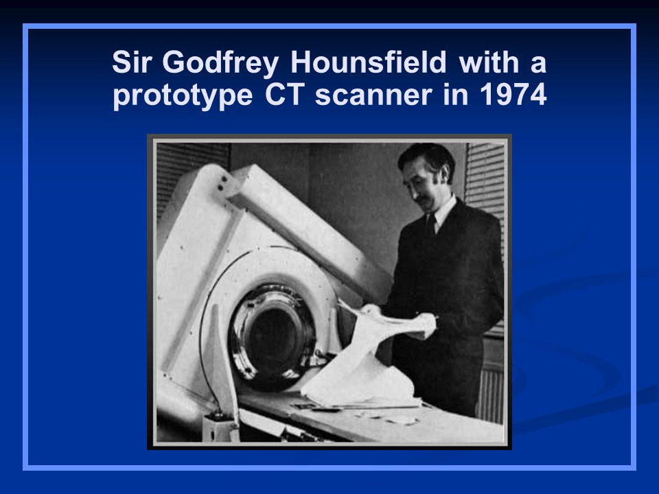 Sir Godfrey Hounsfield with a prototype CT scanner in 1974
