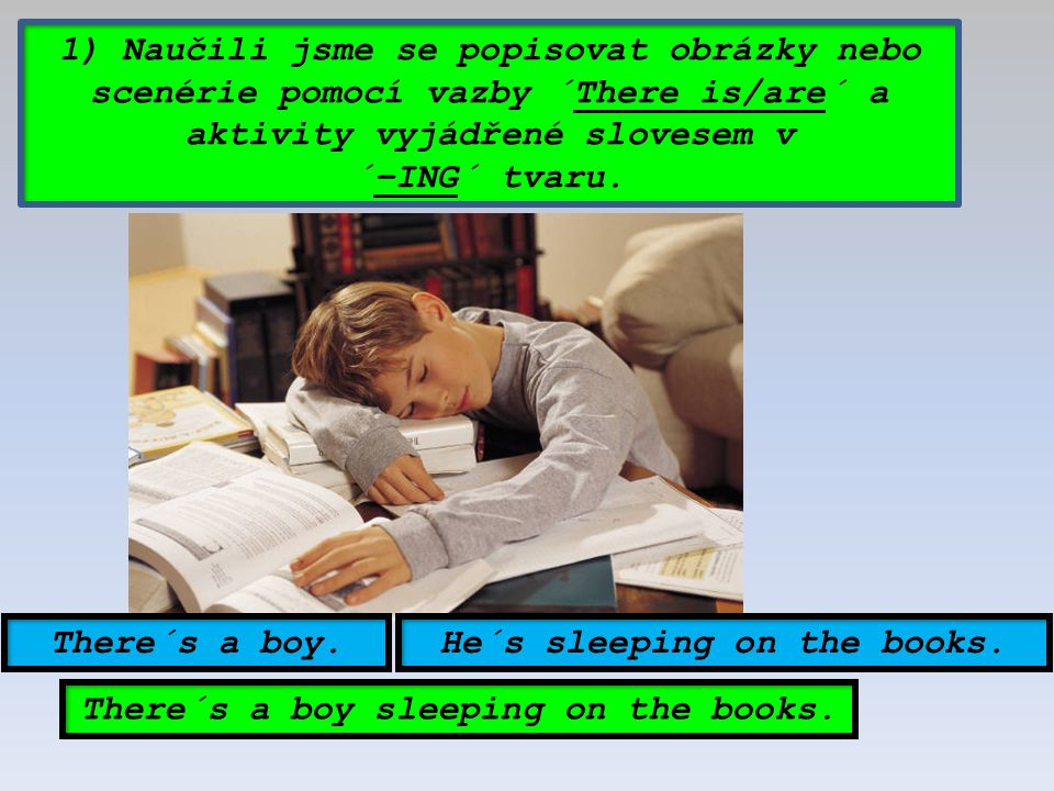 He´s sleeping on the books. There´s a boy sleeping on the books.