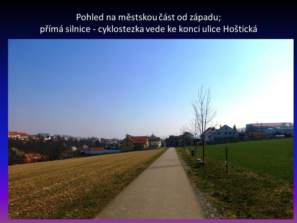 Pohled na městskou část od západu; přímá silnice - cyklostezka vede ke konci ulice Hoštická