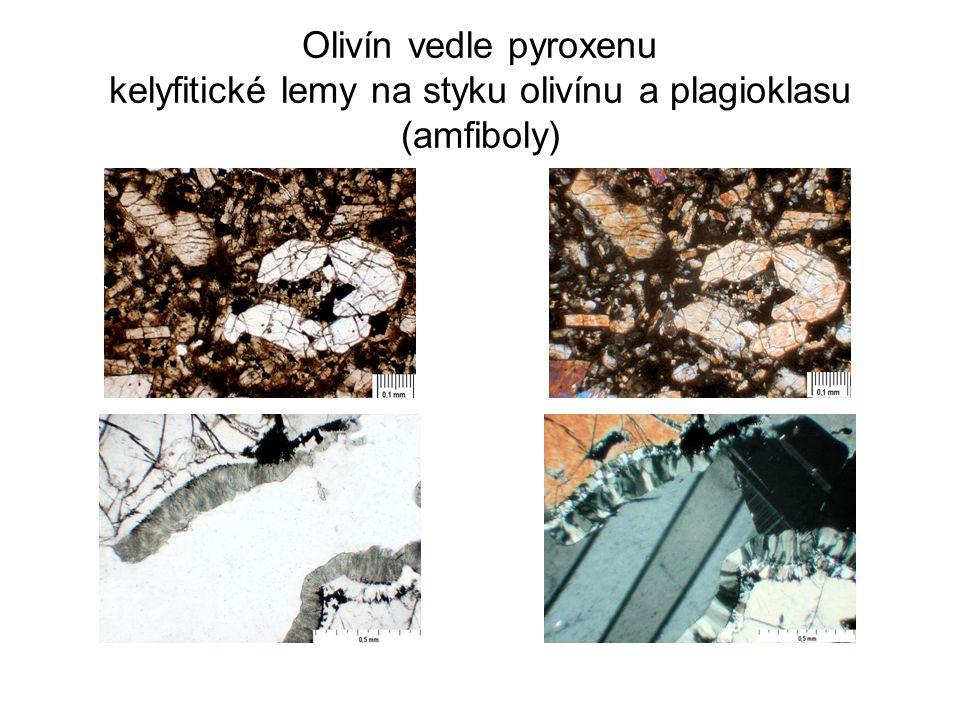 Olivín vedle pyroxenu kelyfitické lemy na styku olivínu a plagioklasu (amfiboly)